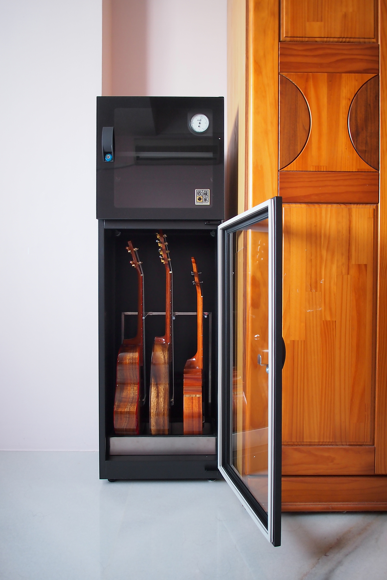 Guitars protected from humidity in Eureka Dry Tech's Auto Dry Box